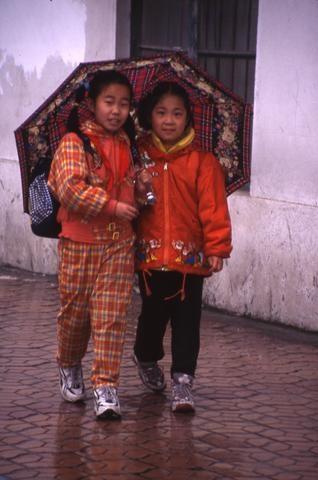 Chinese girls in rain_tif480