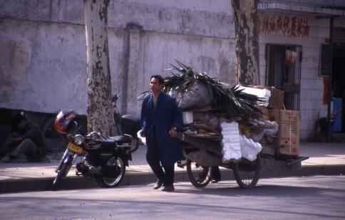 Chinese man pulling cart_tif309